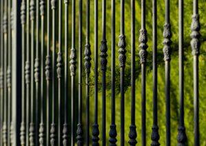 A closeup shot of a black aluminum fence - Big Easy Fences